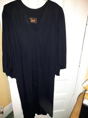 Black Undergraduate gown. Used but in good condition