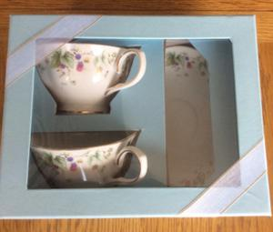 Two china cups and saucers