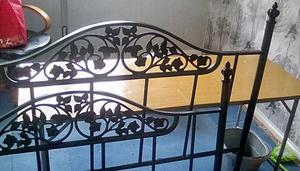 Green metal double bed frame