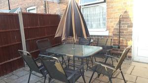 garden table, 6 chairs and parasol