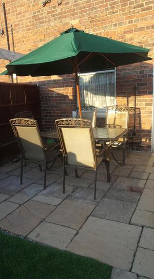 large garden table, 5 chairs and new parasol