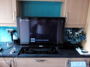 "32"" Toshiba Colour TV with remote control."