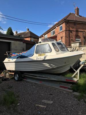 Fishing boat with engine and boat trailer