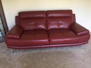 2 Three seater Red Leather Settees.