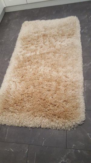Beige soft floor rug