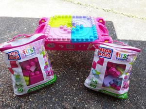 Mega Bloks table and two large bags of bricks