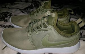 Olive green Nike trainers size 4 basically new.