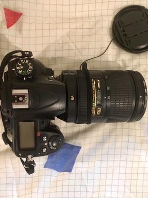 Nikon D camera, AF-S DX NIKKOR mm f/G lens, and Hama bag
