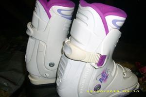 white ladies ski boots,poles and bag