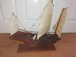 2 large wooden ships on stands