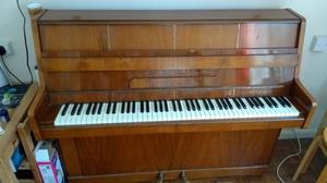 B. Squire - Small upright piano. Two pedals. Good condition all in working order.