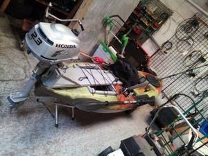 Motorised kayak 3.3mtrs long with fish finder and honda out board with extras ready to go.