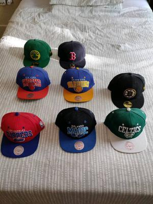 Multiple New Era and Mitchell & Ness Caps