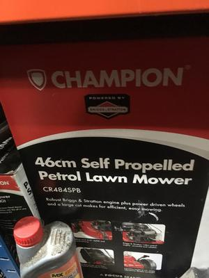 Petrol lawnmower never been used still in box
