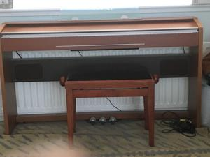 Casio Privia (PX-720) electric piano and piano stool. In immaculate condition. Price new £572.