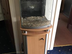 Aquarium on a cupboard stand with lights and filter