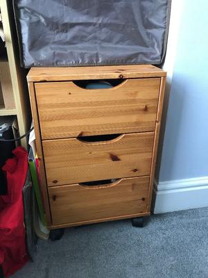Small wooden chest of drawers on casters