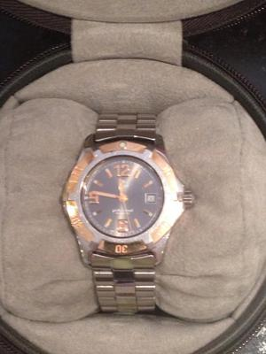 Ladies Tag Heuer Professional watch in stainless steel and 18k rose gold.