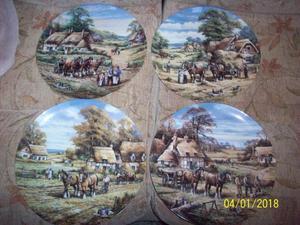 Set of four decorative plates