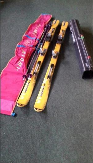 Skis, poles, tube & bag