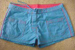 SIZE 12 PAIR BLUE SHORTS WITH TIE FASTENING AT THE FRONT