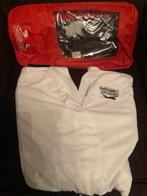 Excellent condition, never used thigh guard, white, cover/case.