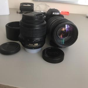 Nikon D DSLR camera with lenses