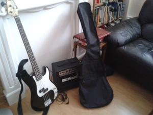 Unused Electric Base Guitar and Amplifier