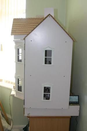 Large 3 floor dolls house, fully furnished with lights