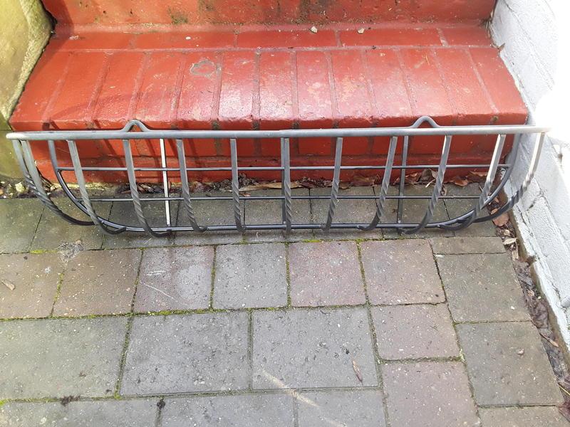 Black iron wall mounted baskets