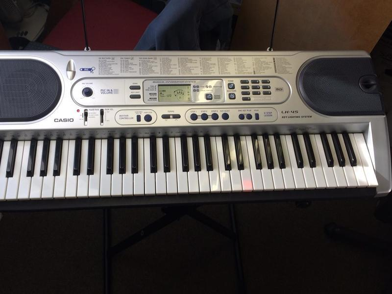 Casio LK45 electronic keyboard with stand