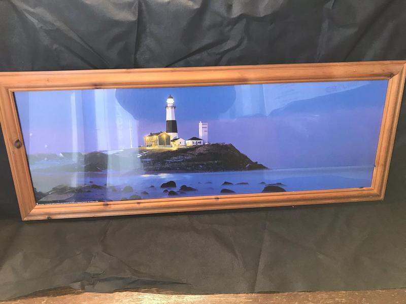 Lovely long picture of a lighthouse scene