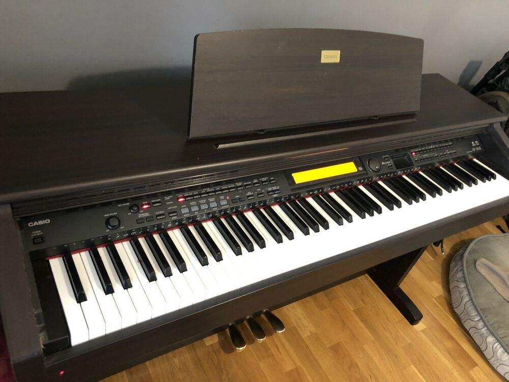 Casio AP-80R Celviano Digital Piano And Piano Stool.