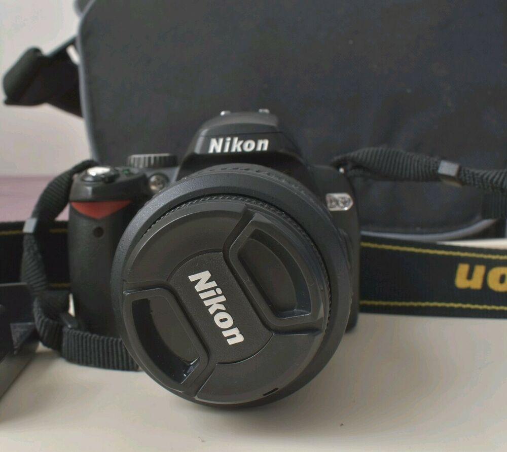 Nikon D60 body + AF-S mm lens + camera bag