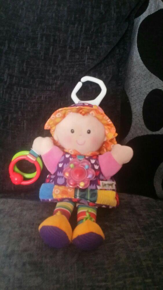 Lamaze Emily doll can hang from car seat / pram etc
