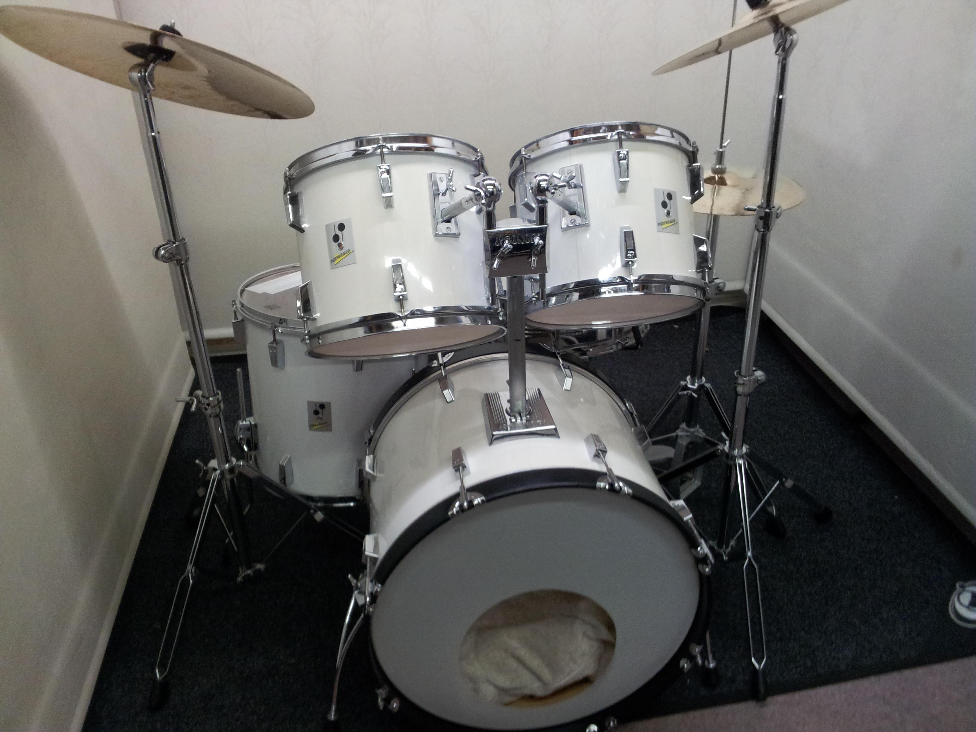 Retired drum teacher has several mid range drum kits for