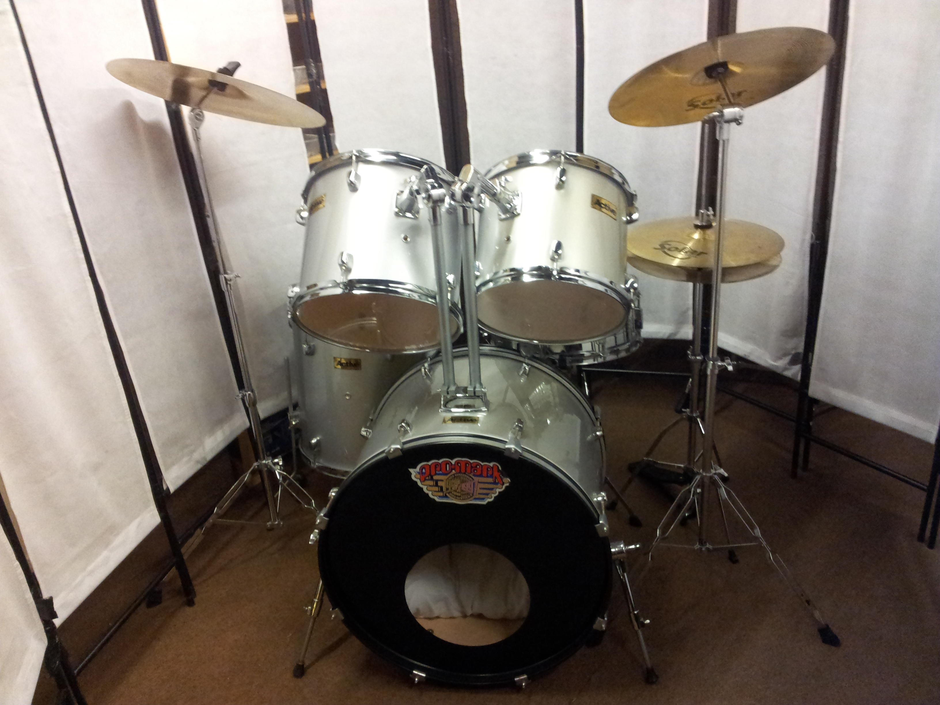 Retired drum teacher has several student drum kits with