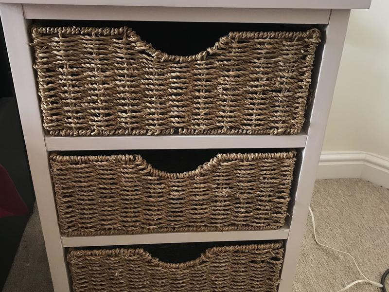 White storage unit with 3 wicker baskets bedroom/lounge