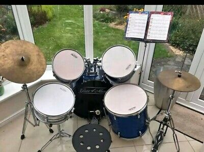 Full Size Starter Drum Kit with a metal stool and music