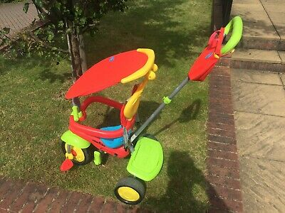 SmarTrike 4-In-1 Baby Trike in Red, Green and Yellow.