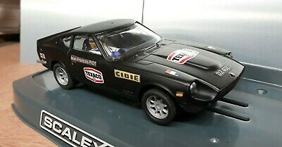 Scalextric Vintage Datsun 260z with NEW minilite wheels.