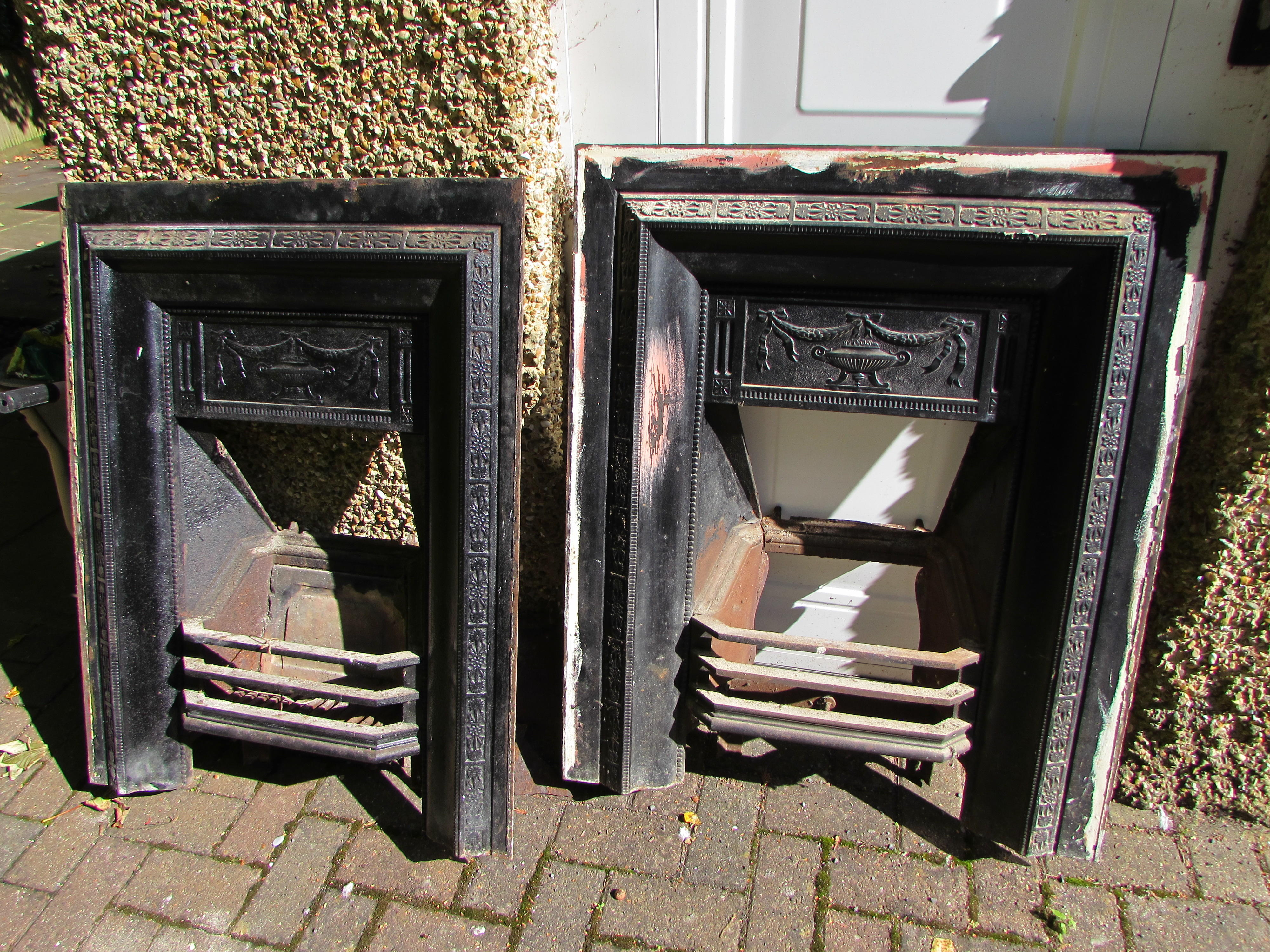 2 x antique iron fireplaces complete with wooden surrounds