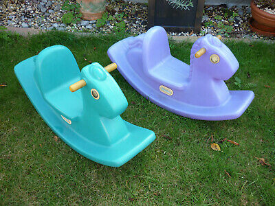 A pair of Little Tikes Rocking Horses - Green and Purple in