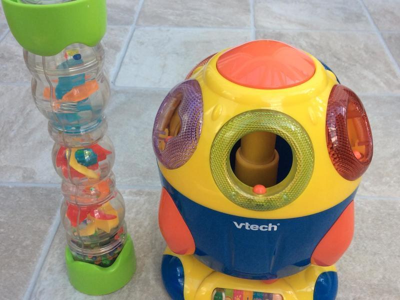 VTech spaceship shape sorter and rain maker.