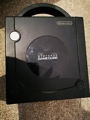 Nintendo GameCube Console with controller and memory card.