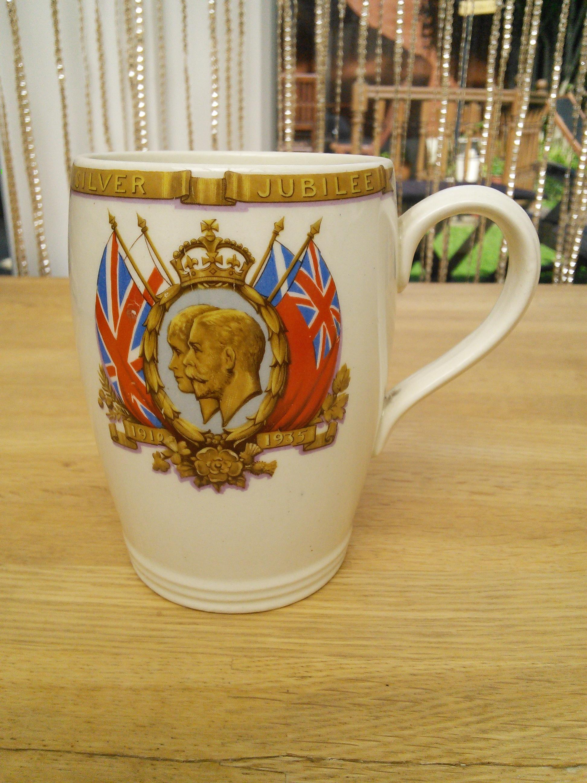 George v and Queen Mary silver jubilee mug.