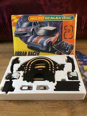 Micro scalextric urban racer Peugeot 206 V bmw Mini Cooper