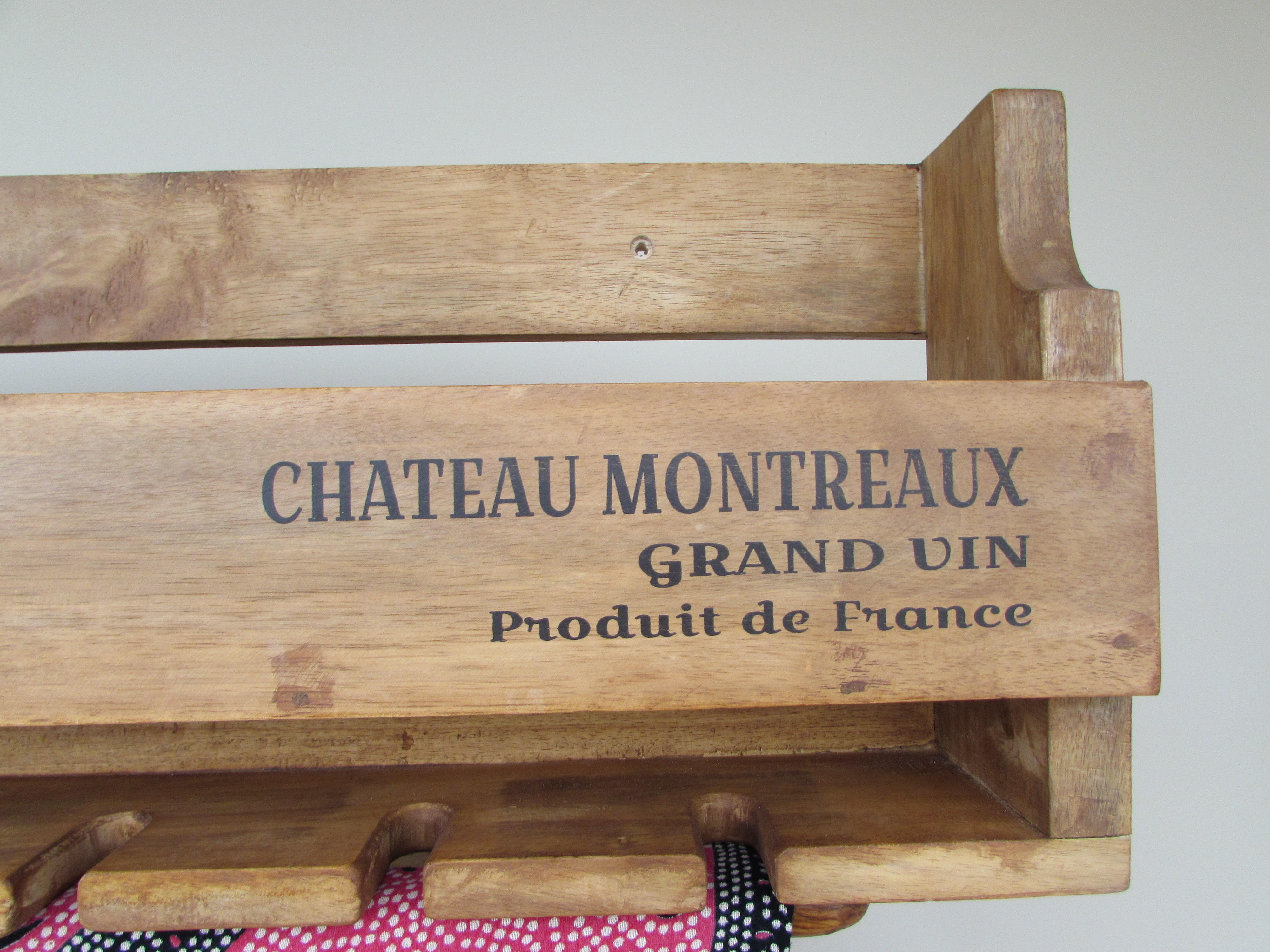 Wall mounted, solid wood Chateau Montreaux wine bottle and