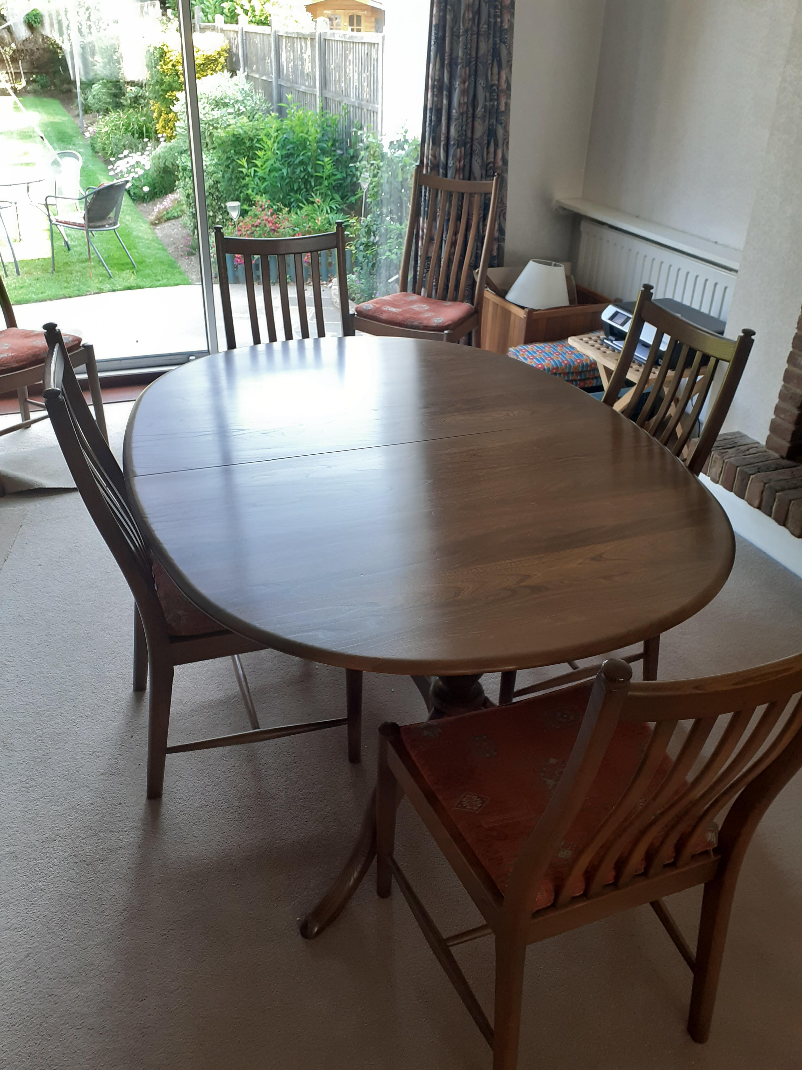Extendable 'medium oak' dining table and chairs set