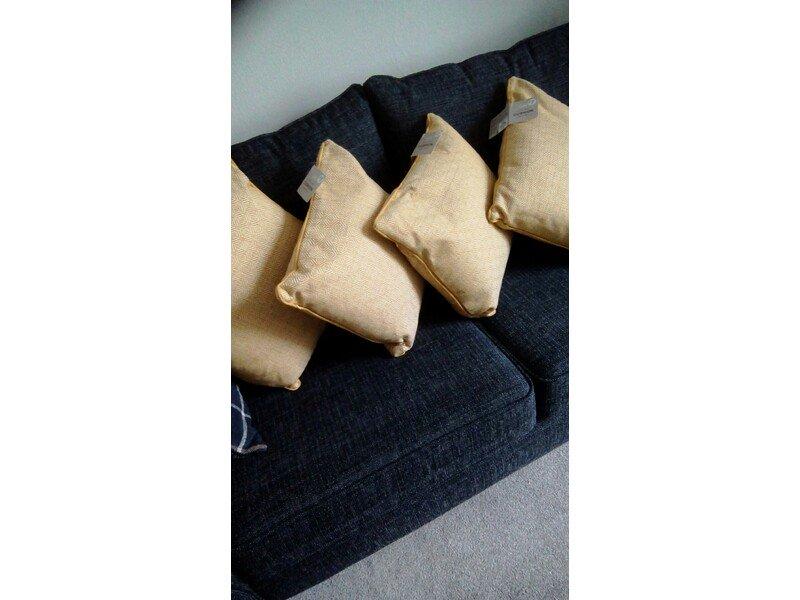 Brand new set of four matching Ochre/Cream cushions.